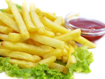French fries with ketchup and lettuce Stock Photo