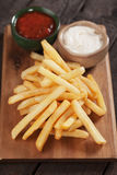French fries with ketchup and mayo Royalty Free Stock Image
