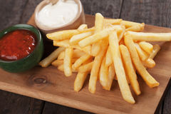 French fries with ketchup and mayo Royalty Free Stock Photos