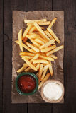 French fries with ketchup and mayo Royalty Free Stock Photo
