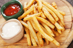 French fries with ketchup and mayonnaise Royalty Free Stock Photos