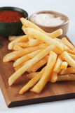 French fries with ketchup and mayonnaise Stock Photos