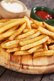 French fries with ketchup and mayonnaise Stock Images