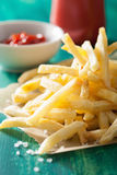 French fries with ketchup over green background Stock Photo