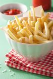 French fries with ketchup over green background Royalty Free Stock Photo