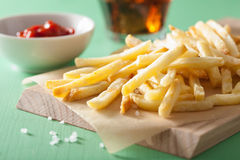 French fries with ketchup over green background Royalty Free Stock Image