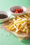 French fries with ketchup over green background Royalty Free Stock Photography