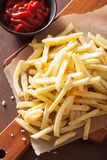 French fries with ketchup over rustic background Royalty Free Stock Images