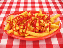 French Fries With Ketchup in a Red Basket Stock Photos