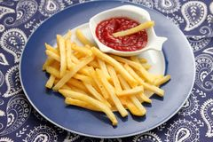 French fries with ketchup. Some french fries with a ketchup of tomatoes Royalty Free Stock Image