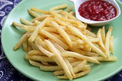 French fries with ketchup. Some french fries with a ketchup of tomatoes Royalty Free Stock Photography