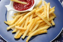 French fries with ketchup. Some french fries with a ketchup of tomatoes Stock Photography