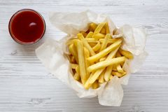 French fries with ketchup on a white wooden table. Top view Stock Photos