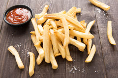 French fries with ketchup on wooden background Stock Image