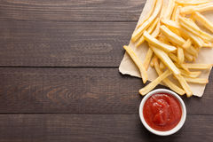 French fries with ketchup on wooden background Royalty Free Stock Image