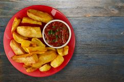 French fries with ketchup on a wooden background. french fries o. N a plate Royalty Free Stock Photos