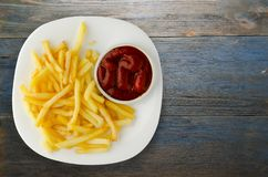 French fries with ketchup on a wooden background. french fries o. N a plate Stock Image