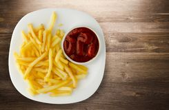 French fries with ketchup on a wooden background. french fries o Royalty Free Stock Images