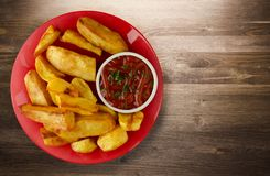 French fries with ketchup on a wooden background. french fries o Royalty Free Stock Photo