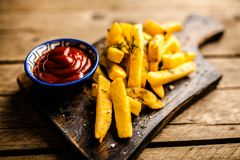French fries on wooden table Royalty Free Stock Images