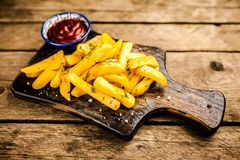 French fries on wooden table Royalty Free Stock Image