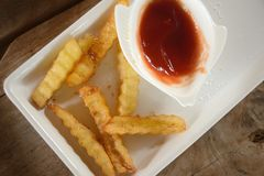 French fries with ketchup on  wooden table. Top view Stock Photo