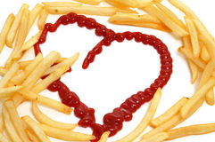 French fries love. Some french fries and a heart drawn with ketchup Royalty Free Stock Images