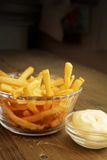 French fries with mayonnaise. French fries with salt and mayonnaise in a clear bowl Stock Photography