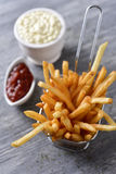 French fries, mayonnaise and ketchup Royalty Free Stock Image