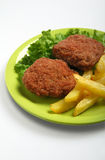 French fries and meatballs royalty free stock image