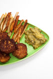 French fries with meatballs and peas on a plate Royalty Free Stock Photography