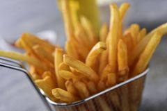 French fries in a metal basket Royalty Free Stock Photos