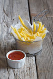 French fries in metal basket with tomato ketchup Stock Photo