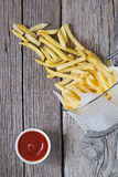 French fries in metal basket with tomato ketchup Royalty Free Stock Photos