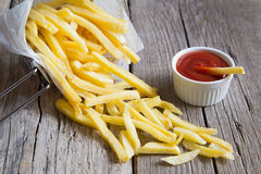 French fries in metal basket with tomato ketchup Royalty Free Stock Image