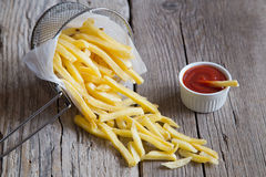 French fries in metal basket with tomato ketchup Stock Photography
