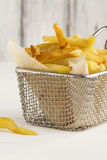 French fries in metal wire basket Royalty Free Stock Photos