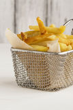 French fries in metal wire basket Royalty Free Stock Image