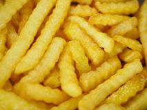 French fries in oil Royalty Free Stock Photo