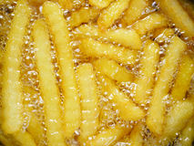 French fries in oil Stock Image