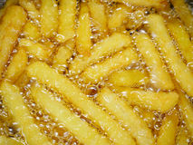 French fries in oil Royalty Free Stock Photos