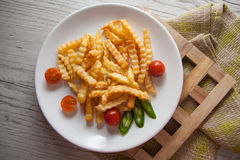 French Fries On Wooden Background Royalty Free Stock Photography