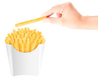 French fries in packaging with hand Royalty Free Stock Image