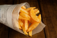 French fries in packet. French fries in rolled newspaper packet or packaging Stock Images