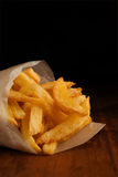 French fries in packet. French fries in rolled newspaper packet or packaging Stock Image