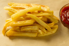 French fries in paper bag Stock Photography