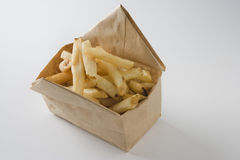 French Fries in a Paper Bag Container. Photograph of french fries in a paper bag container on a white background royalty free stock photography