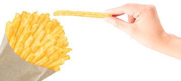 French fries in paper bag with hand. French fries in packaging with hand holding one above Royalty Free Stock Photo
