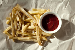 French fries on paper Royalty Free Stock Images