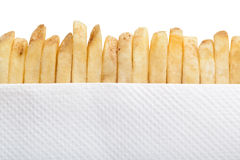 French fries and paper napkin Stock Images